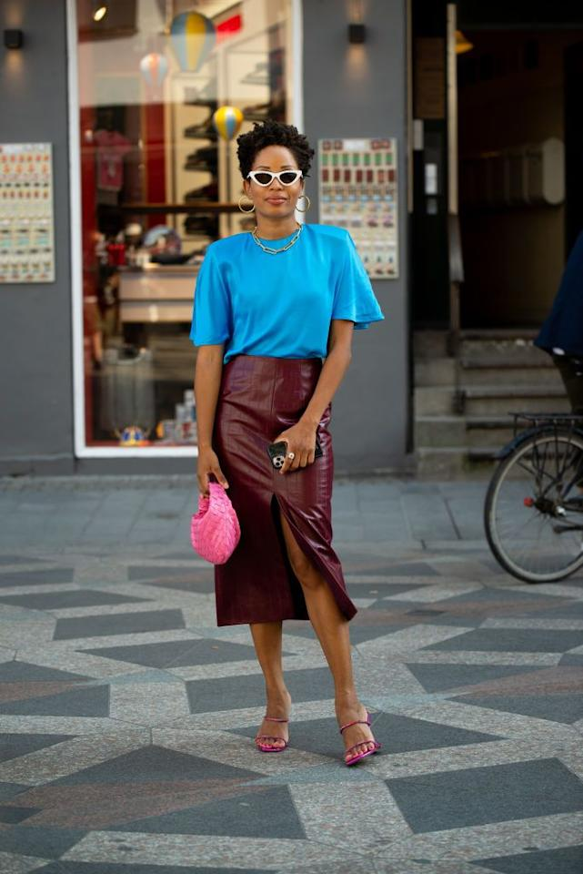<p>Ellie Delphine knows her way around color play—pairing bold blue with subdued burgundy and shocks of pink accessories. </p>
