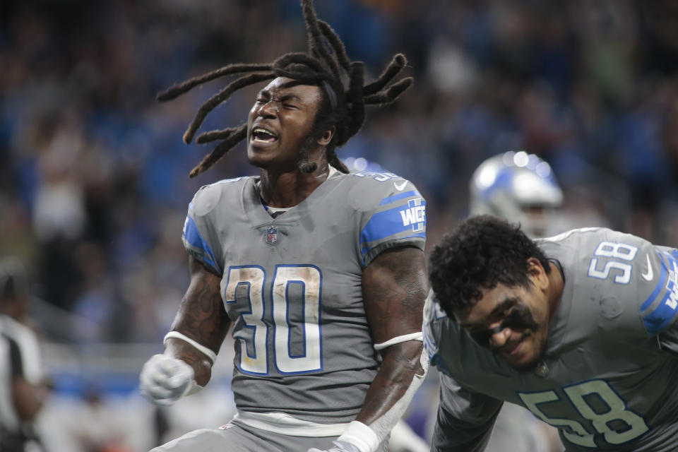 Detroit Lions running back Jamaal Williams (30) reacts to scoring a one-yard touchdown run against the Baltimore Ravens in the second half of an NFL football game in Detroit, Sunday, Sept. 26, 2021. (AP Photo/Tony Ding)