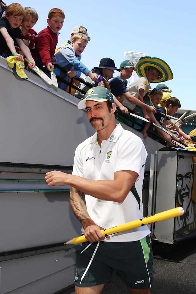 MELBOURNE, AUSTRALIA - DECEMBER 29:  Mitchell Johnson of Australia walks to the change rooms with a stump after victory during day four of the Fourth Ashes Test Match between Australia and England at Melbourne Cricket Ground on December 29, 2013 in Melbourne, Australia.  (Photo by Michael Dodge/Getty Images)