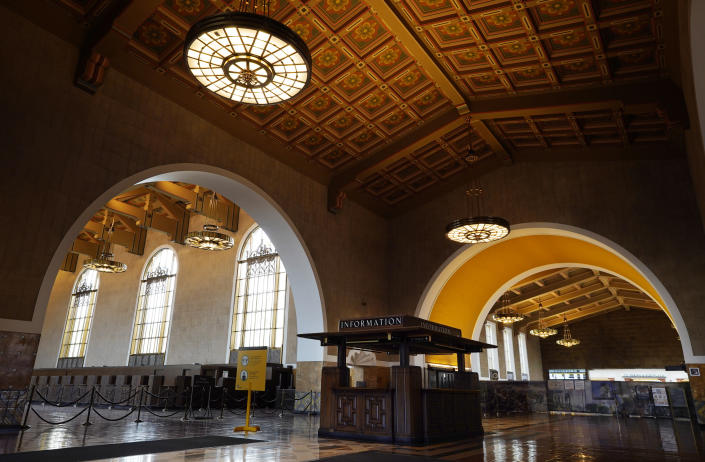 The interior of Union Station in Los Angeles appears on March 23, 2021. The Oscars are headed to the historic site for the first time this year. With wide open spaces and 65-foot high ceilings, it's ideal for a big crew and cameras. It's been used in car commercials, reality shows and procedurals. But its beamed ceilings, Spanish tile floors and regal bronze chandeliers really shine in cinema where it's played train stations, banks, police stations, clubs and airports. (AP Photo/Chris Pizzello)