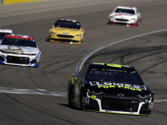 "<a class=""link rapid-noclick-resp"" href=""/nascar/sprint/drivers/213/"" data-ylk=""slk:Jimmie Johnson"">Jimmie Johnson</a>, right, drives during a NASCAR Cup series auto race Sunday, March 4, 2018, in Las Vegas. (AP Photo/Isaac Brekken)"