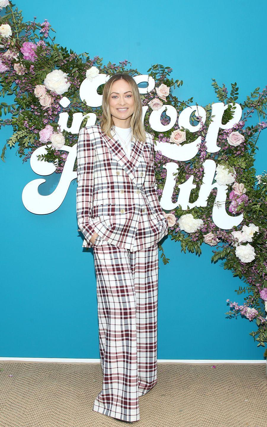<p>Rubbing shoulders with Gwyneth Paltrow called for a checked Antonio Berardi suit with a white T-shirt for Wilde. </p>