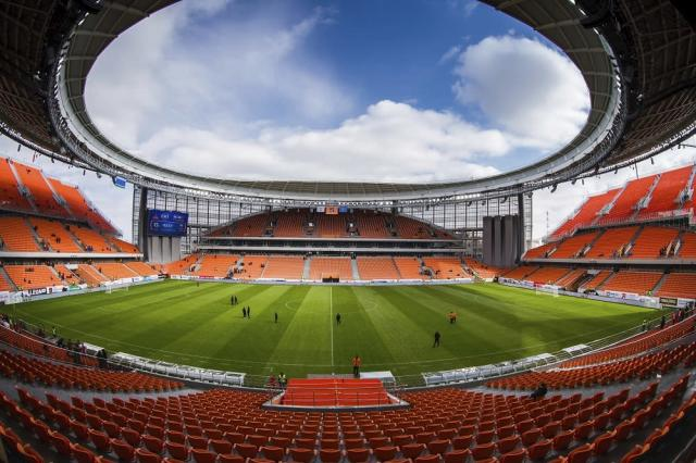 In this photo taken on Sunday, April 1, 2018, a view from the stands of the new World Cup stadium in Yekaterinburg during the Russian premier league soccer match between Ural Yekaterinburg and Rubin Kazan in Russia. (AP Photo/Anton Basanaev)