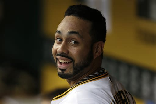 Pittsburgh Pirates' Pedro Alvarez smiles in the dugout after hitting a two-run home run off New York Mets starting pitcher Jeremy Hefner iin the first inning of a baseball game in Pittsburgh on Friday, July 12, 2013. (AP Photo/Gene J. Puskar)