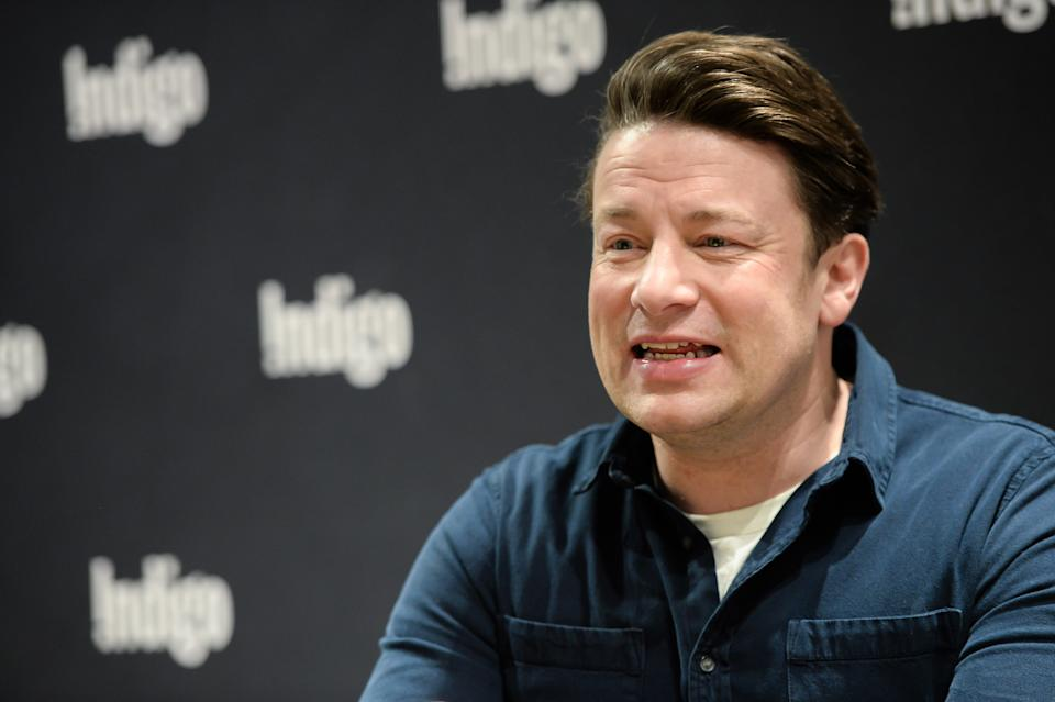 TORONTO, ONTARIO - JANUARY 09: Jamie Oliver signs copies of his new book