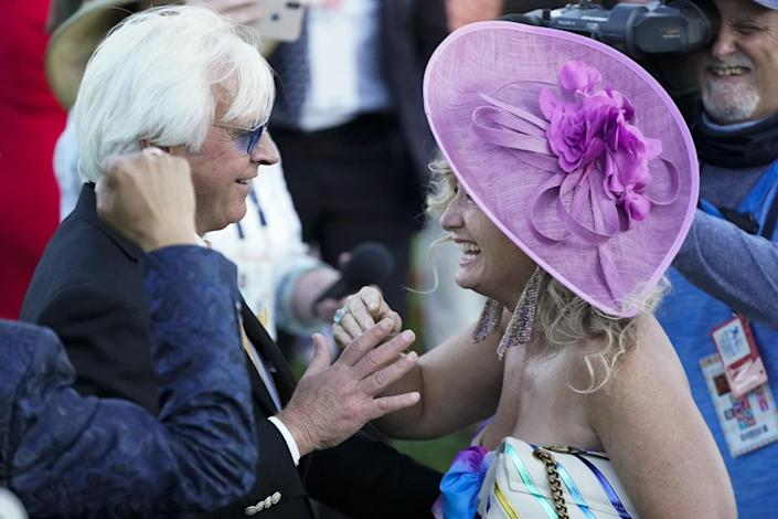 Trainer Bob Baffert is greeted by his wife, Jill, after winning the Kentucky Derby with Medina Spirit.