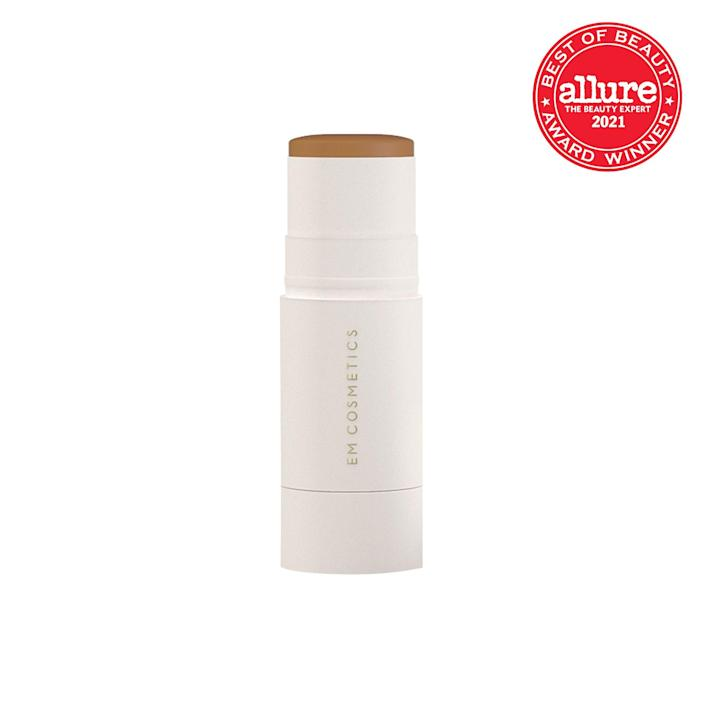 """News flash: Cream bronzers are having a serious moment. Need proof? Em Cosmetics' So Soft Bronzer is a beginner-friendly way of sculpting your face and adding some serious dimension — and with a satin, looks-like-skin finish, of course. Like many of the brand's products, this convenient stick is enhanced with <a href=""""https://www.allure.com/story/squalane-vs-squalene-skin-care-difference?mbid=synd_yahoo_rss"""" rel=""""nofollow noopener"""" target=""""_blank"""" data-ylk=""""slk:squalane"""" class=""""link rapid-noclick-resp"""">squalane</a> and <a href=""""https://www.allure.com/story/vitamin-e-skin-care?mbid=synd_yahoo_rss"""" rel=""""nofollow noopener"""" target=""""_blank"""" data-ylk=""""slk:vitamin E"""" class=""""link rapid-noclick-resp"""">vitamin E</a> to hydrate and condition skin. Summer, shown above, is a delicious toasted caramel with warm undertones for fair to tan skin and will give you a glow free from sun damage in just a few swipes."""