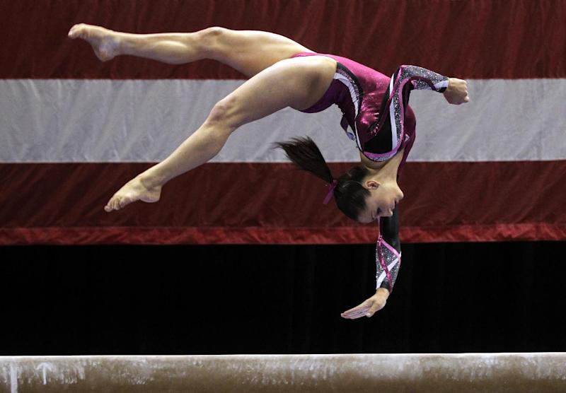 Jordyn Wieber competes in balance beam during the women's senior division at the U.S. gymnastics championships on Sunday, June 10, 2012, in St. Louis. Wieber took first place overall in the competition. (AP Photo/Jeff Roberson)