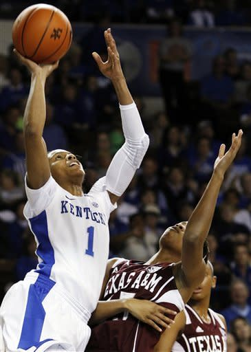 Kentucky's A'dia Mathies (1) shoots next to Texas A&M's Tori Scott during the first half of an NCAA college basketball game at Memorial Coliseum in Lexington, Ky., Thursday, Jan. 10, 2013. (AP Photo/James Crisp)