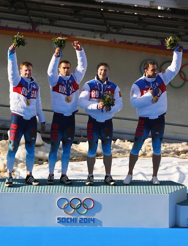 SOCHI, RUSSIA - FEBRUARY 23: Gold medalists Russia team 1 celebrate on the podium during the medal ceremony for the Four-Man Bobsleigh on Day 16 of the Sochi 2014 Winter Olympics at Sliding Center Sanki on February 23, 2014 in Sochi, Russia. (Photo by Mike Ehrmann/Getty Images)
