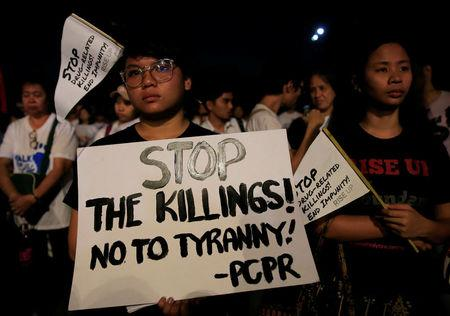 """Participants display placards during """"Walk for Life"""" in Luneta park, Metro Manila"""
