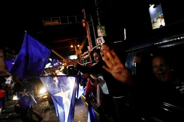 <p>Supporters of President Juan Orlando Hernandez, who is also National Party presidential candidate, celebrate as they wait for official presidential election results in Tegucigalpa, Honduras, Nov. 29, 2017. (Photo: Edgard Garrido/Reuters) </p>