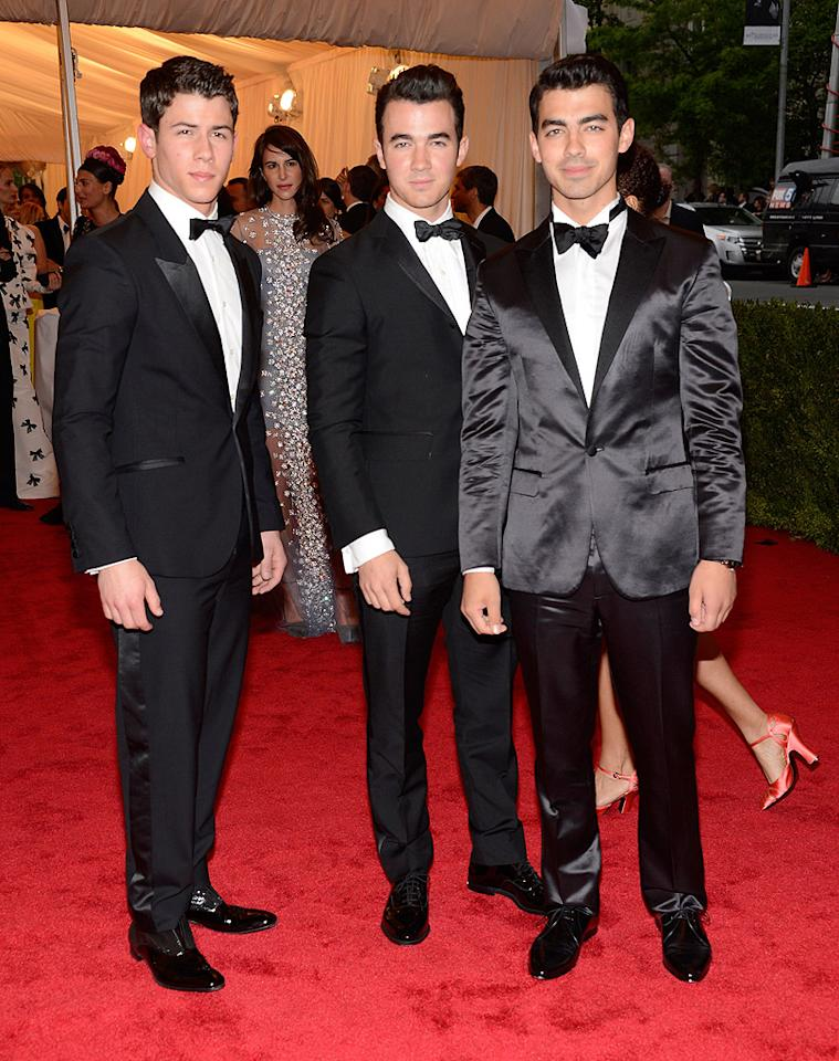 "<p class=""MsoNormal""><span style="""">One of these brothers is not like the others! Joe Jonas (right) stood out in this trio of JoBros thanks to his satin Calvin Klein tuxedo, while Nick (left) and Kevin kept things more subdued. </span></p>"