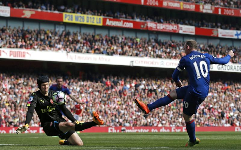 Arsenal's Petr Cech saving a shot by Manchester United's Wayne Rooney on 7 May 2017 - AFP