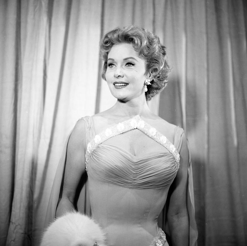 Actress Rhonda Fleming pose at a party in Los Angeles, California.