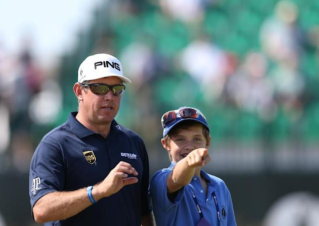 Lee Westwood of England and his son Sam look along the 4th fairway during a practice round ahead of the British Open Golf championship at the Royal Liverpool golf club, Hoylake, England, Tuesday July 15, 2014. The British Open Golf championship starts Thursday July 17. (AP Photo/Scott Heppell)