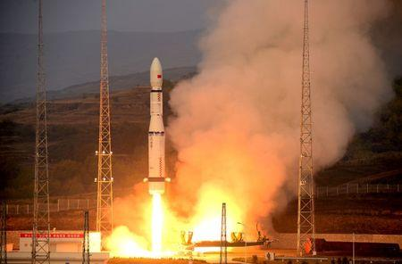 China's Long March-6 rocket, carrying 20 micro-satellites, blasts off from the launch pad in Taiyuan