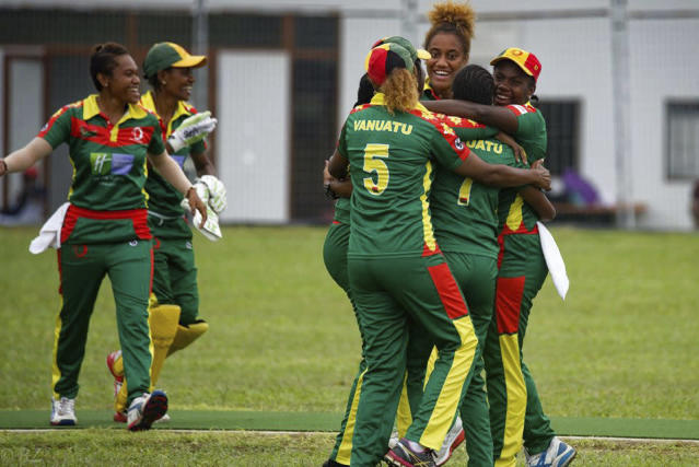 In this May, 2019, photo provided by the Vanuatu Cricket Association players celebrate during a women's cricket match in Port Vila, Vanuatu. The tropical island in the South Pacific is very likely to be the only venue in the world hosting a competitive cricket final on Saturday, as most international sport remains shuttered around the globe. (Ron Zwiers/Vanuatu Cricket Association via AP)