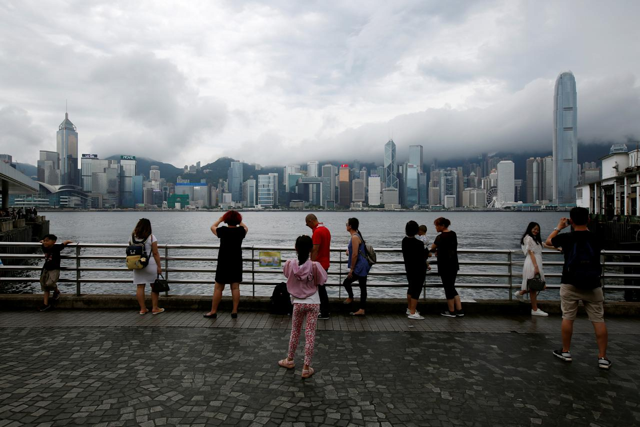 People gather at a waterfront as Typhoon Roke approaches Hong Kong, China July 23, 2017. REUTERS/Bobby Yip TPX IMAGES OF THE DAY