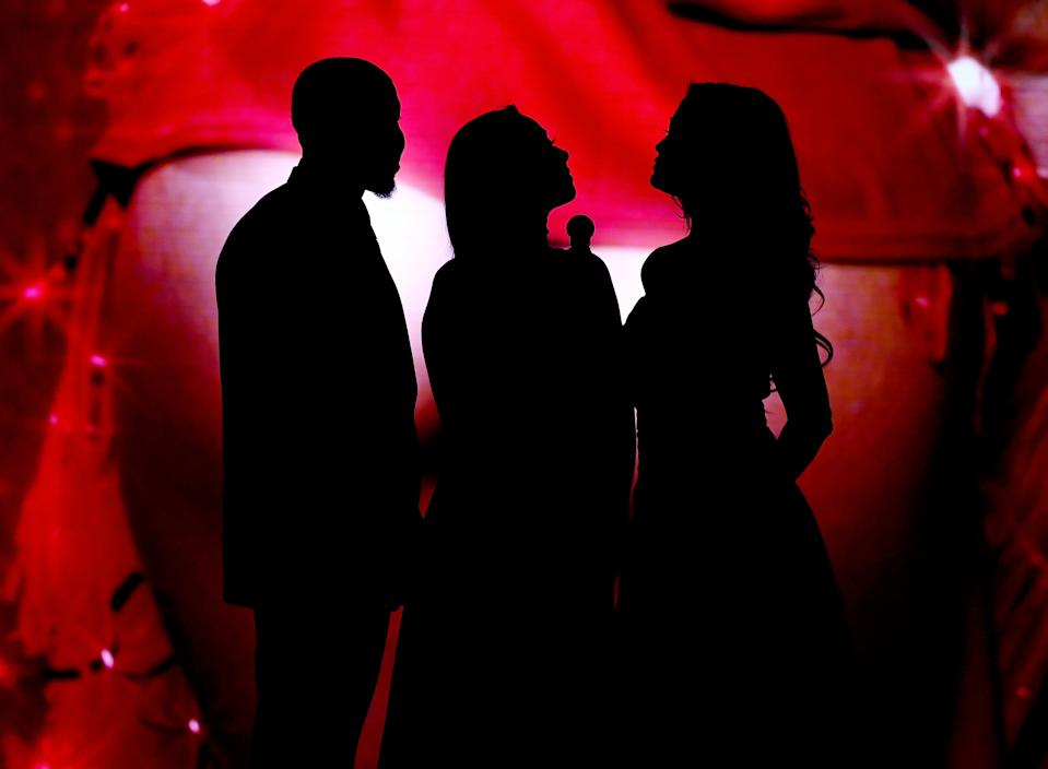 Silhouetted adult-film actors present an award during the 2017 Adult Video News Awards in Las Vegas