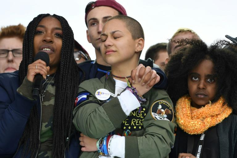 "Marjory Stoneman Douglas High School student Emma Gonzalez (C) at the 2018 ""March for Our Lives"" rally in Washington"