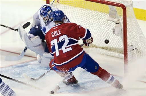 Toronto Maple Leafs goaltender Ben Scrivens, left, is scored on by Montreal Canadiens' Max Pacioretty, not shown, as Canadiens' Erik Cole pressures the net during the second period of an NHL hockey game in Montreal, Saturday, April 7, 2012. (AP Photo/The Canadian Press, Graham Hughes)