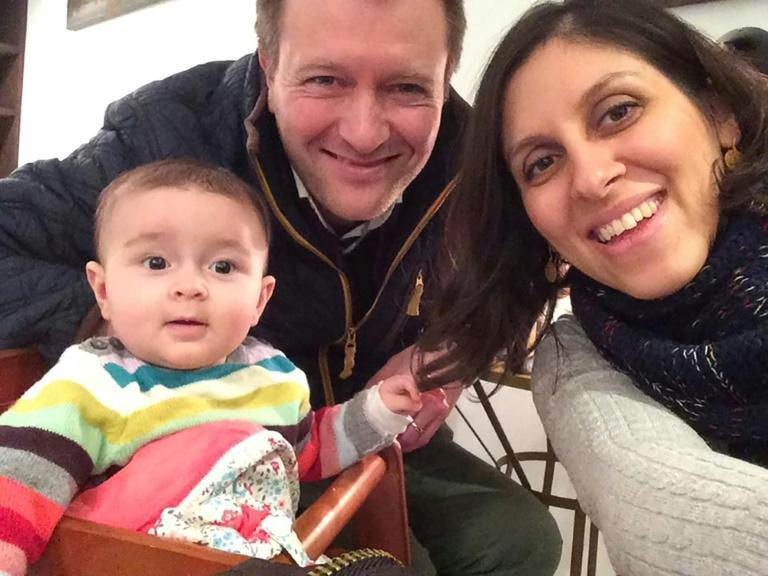 This undated file handout image shows Nazanin Zaghari-Ratcliffe posing for a photograph with her husband Richard and daughter Gabriella