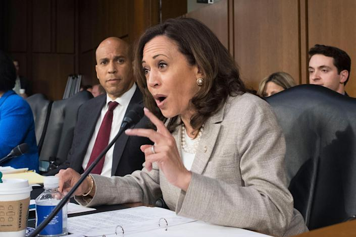 Harris questions witnesses as Sen. Cory Booker listens during Senate Judiciary Committee hearings on Judge Brett Kavanaugh's nomination to the Supreme Court. (Michael Reynolds/EPA-EFE/Shutterstock)