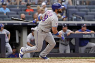 New York Mets' Jose Peraza hits a two-RBI double during the seventh inning of the first baseball game of a doubleheader against the New York Yankees on Sunday, July 4, 2021, in New York. (AP Photo/Adam Hunger)