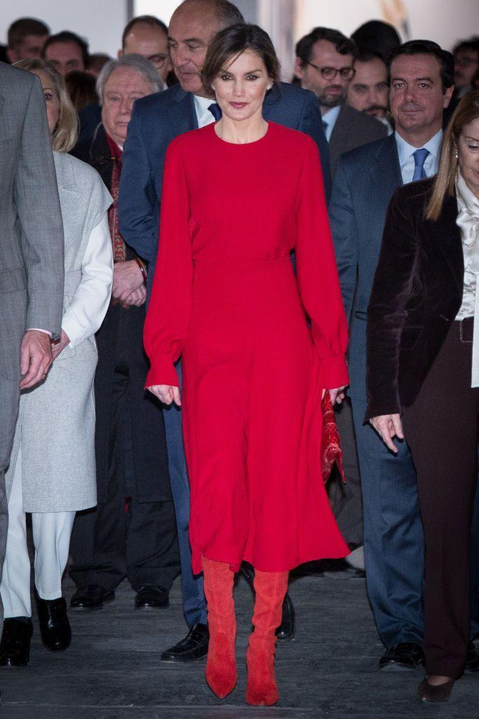 <p>The Queen was a vision in red at the opening of an art fair in Madrid. She chose a long-sleeved red dress and red suede heeled boots. </p>