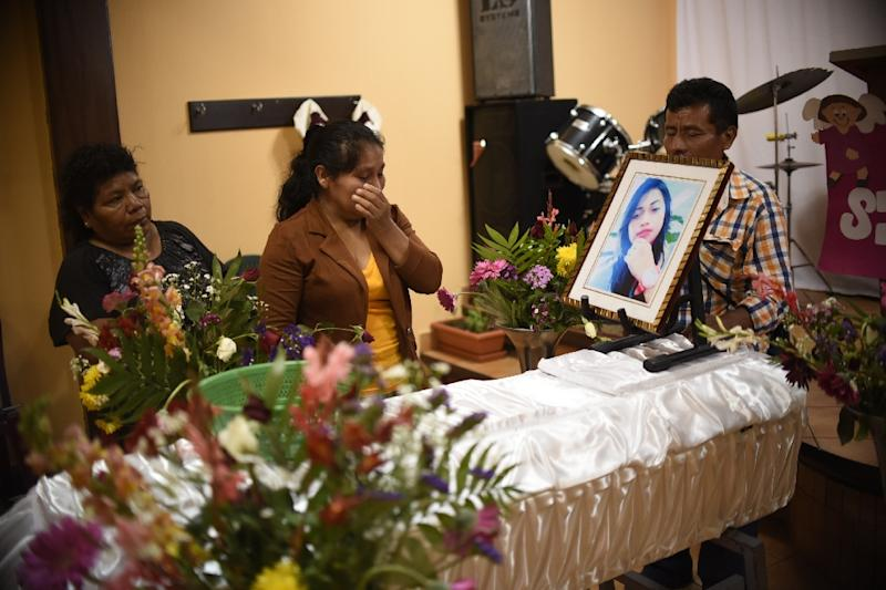 Marta Lidia Garcia (C) cries by the coffin of her 17-year-old daughter, Siona Hernandez, who died in a fire at a state-run shelter, during the wake on March 10, 2017, south of Guatemala City (AFP Photo/Johan ORDONEZ)