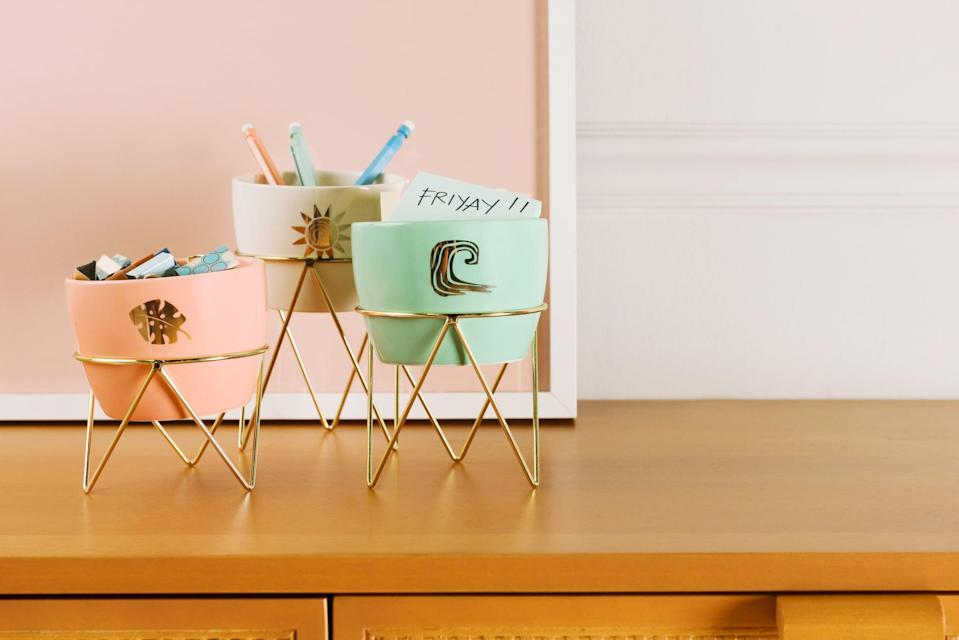 <p>From Post-Its to pens and pencils, the <span>Disney Princess X POPSUGAR Moana Planters</span> ($25 for three) also make great little desk organizers. The stands keep them from taking up too much valuable surface space.</p>