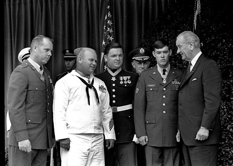 "FILE - In this May 14, 1968 file photo, U.S. President Lyndon Johnson, right, poses at the White House with four winners of the nation's highest award, the Medal of Honor. Decorated for valor in Vietnam, they are, from left: Air Force Capt. Gerald O. Young, of Anacortes, Wash.; Navy Bosn""s Mate James E. Williams, of Rock Hill, S.C.; Marine Sgt. Richard A. Pittman, of Stockton, Calif., and Army Spc. 5  Charles C. Hagmeister, of Lincoln, Neb.  Others are unidentified. Pittman and the other recipients can proudly and truthfully say they were awarded the Medal of Honor for their valor in Vietnam. After a recent Supreme Court ruling, anyone else is free under the First Amendment to make the same claim, whether it's true or not. (AP Photo/File)"