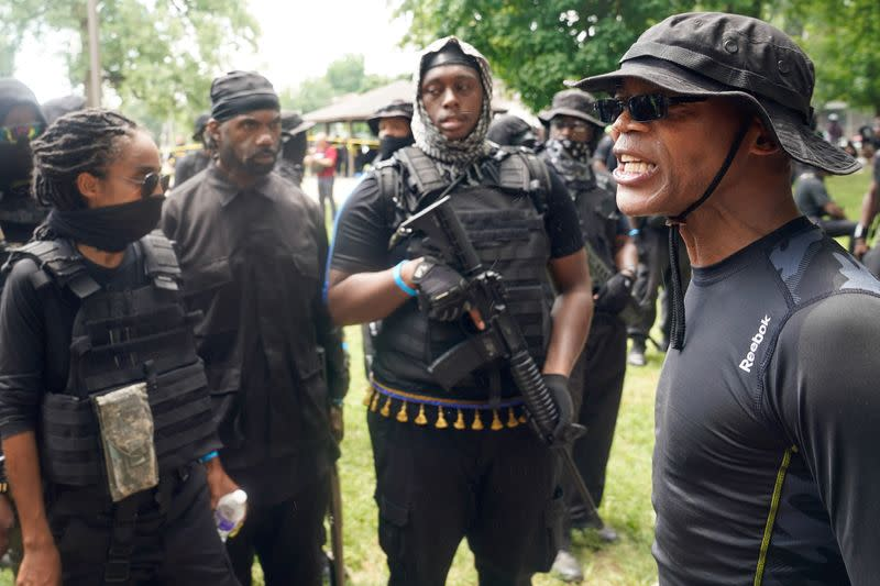 Members and supporters of an all-Black militia group called NFAC hold an armed rally in Louisville