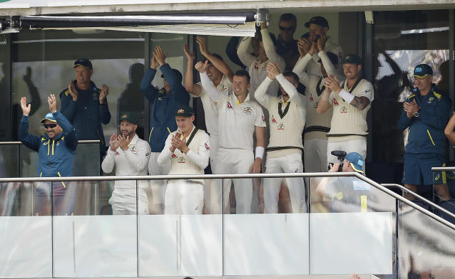 Australia's players celebrate Smith's ton, who bailed most of them out of jail. (Photo by Ryan Pierse/Getty Images)