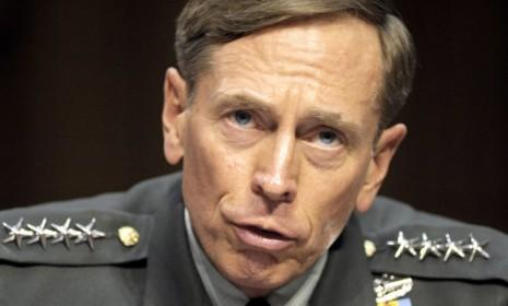Then-CIA Director-desigate Gen. David Petraeus testifies on Capitol Hill in Washington in June 2011: On Monday the FBI removed boxes of materials from the home of Petraeus' mistress, Paula Broadwell.