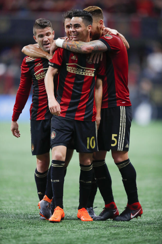 Atlanta United midfielder Miguel Almiron (10) celebrates with teammates after scoring in the second half of an MLS soccer game against the D.C. United on Sunday, March 11, 2018, in Atlanta. The Atlanta United won the game 3-1. (AP Photo/Todd Kirkland)