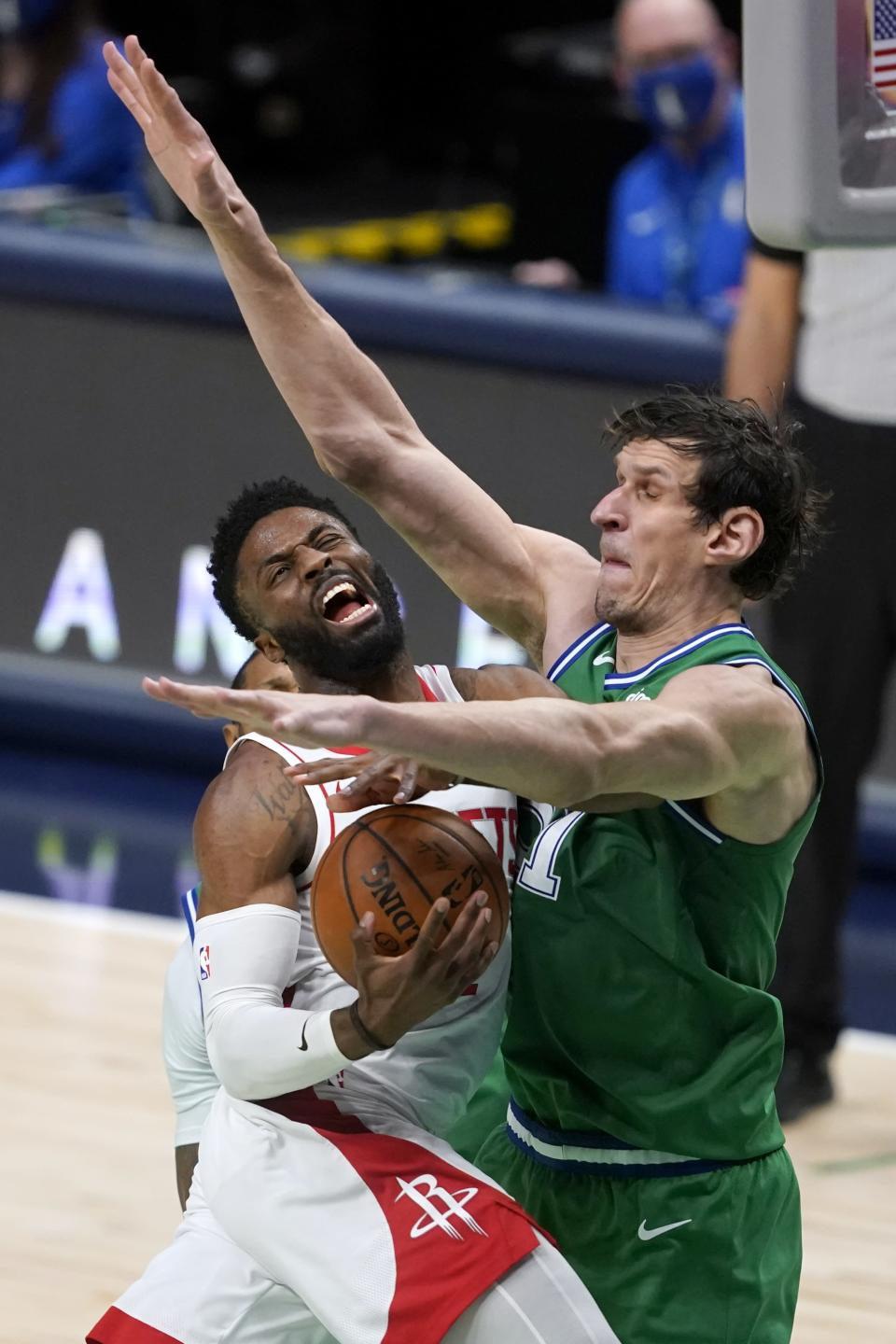 Houston Rockets guard David Nwaba (2) is unable to reach the basket for a shot as Dallas Mavericks' Boban Marjanovic (51) defends during the second half of an NBA basketball game in Dallas, Saturday, Jan. 23, 2021. (AP Photo/Tony Gutierrez)
