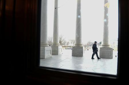 U.S. Capitol police officer patrols the West Front of the U.S. Capitol in Washington