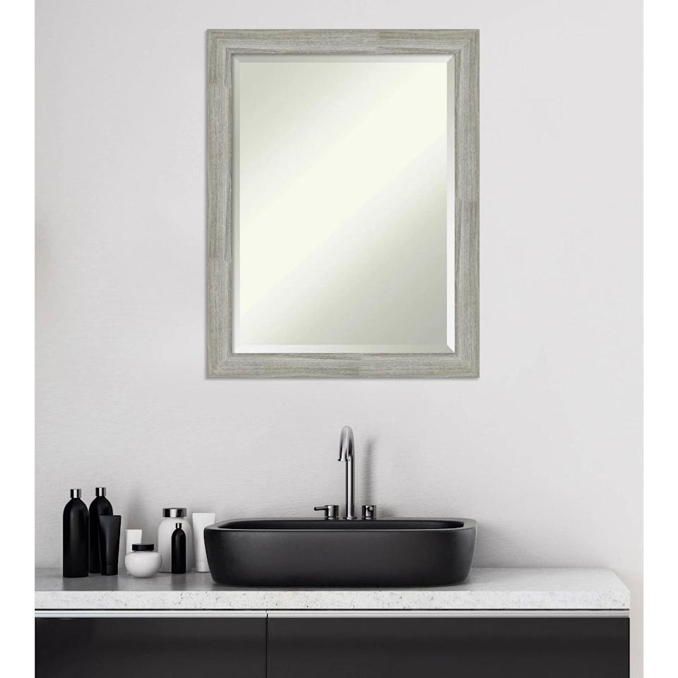 <p>Add a rustic yet modern touch with this <span>Amanti Art Dove Graywash Framed Vanity Wall Mirror</span> ($74).</p>