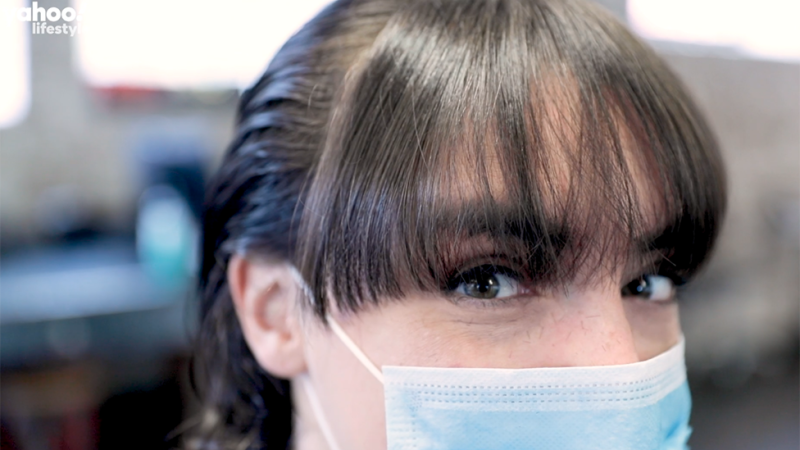Image of girl wearing mask with fringe haircut