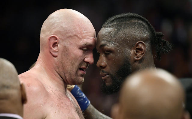 Tyson Fury, left, of England, and Deontay Wilder embrace after their WBC heavyweight championship boxing match, Saturday, Dec. 1, 2018, in Los Angeles. The fight ended in a draw. (AP Photo/Mark J. Terrill)