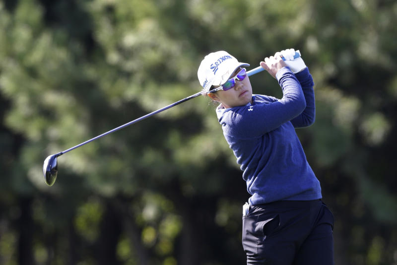 Nasa Hataoka of Japan watches her shot on the second hole during the first round of the LPGA KEB Hana Bank Championship at Sky72 Golf Club in Incheon, South Korea, Thursday, Oct. 11, 2018. (AP Photo/Ahn Young-joon)