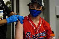 Williams Hughes, of Savannah, Ga., gets a COVID-19 vaccine before a baseball game between the Atlanta Braves and the Philadelphia Phillies, Friday, May 7, 2021, in Atlanta. The Braves were offering free tickets to an upcoming game to fans who got the shot. (AP Photo/John Bazemore)