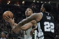 Milwaukee Bucks' Giannis Antetokounmpo is fouled by San Antonio Spurs' Rudy Gay during the first half of an NBA basketball game Saturday, Jan. 4, 2020, in Milwaukee. (AP Photo/Morry Gash)