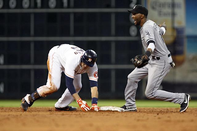 Houston Astros' Jason Castro (15) is safe at second base as Chicago White Sox's Alexei Ramirez (10) misses the tag in the third inning of a baseball game Monday, June 17, 2013, in Houston. (AP Photo/Eric Kayne)
