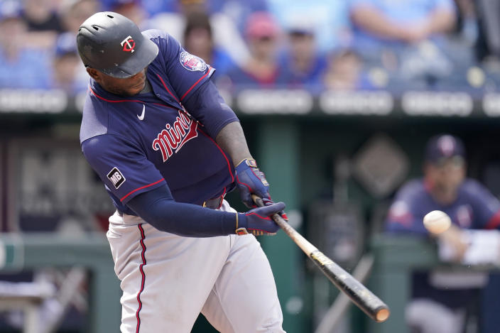 Minnesota Twins' Miguel Sano hits a two-run home run during the sixth inning of a baseball game against the Kansas City Royals Saturday, June 5, 2021, in Kansas City, Mo. (AP Photo/Charlie Riedel)
