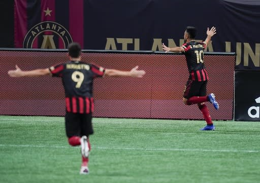 Atlanta United midfielders Gonzalo Martinez, right, Matheus Rossetto (9) celebrate a goal during the first half of the team's MLS soccer match against Nashville SC on Saturday, Aug. 22, 2020, in Atlanta. (AP Photo/Brynn Anderson)