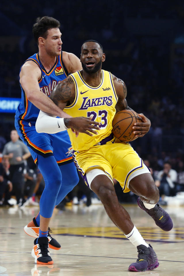 Los Angeles Lakers' LeBron James (23) is fouled by Oklahoma City Thunder's Danilo Gallinari (8) during the first half of an NBA basketball game Tuesday, Nov. 19, 2019, in Los Angeles. (AP Photo/Ringo H.W. Chiu)