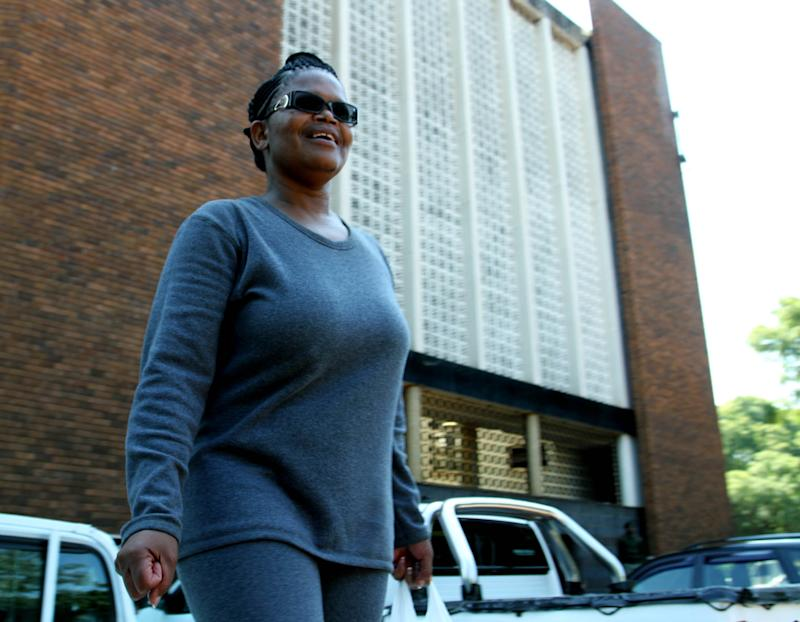 Human rights lawyer, Beatrice Mtetwa arrives at court in Harare, Tuesday, March 19, 2013. Police have charged Mtetwa for obstructing justice after ignoring a judge's order to release her a day earlier. Mtetwa was arrested Sunday while representing four opposition members of the prime minister's party while  undergoing police searches. (AP Photo)
